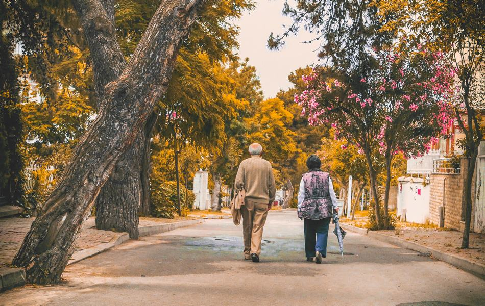 Elderly Insomnia - Man And Woman Walking On The Street - Vitamin D