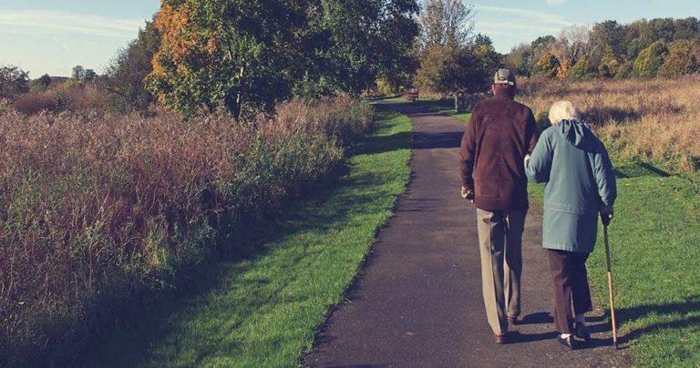 Elderly couple walking in country