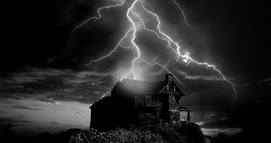 house on hill in thunderstorm