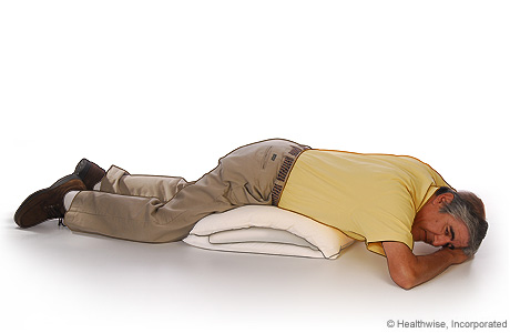 Sleep-on-Your-Stomach-and-Place-a-Pillow-Under